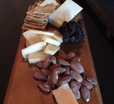 What goes best with a delicious cheese platter? Wine of course! - Blue Table Wine & Cheese Bar.