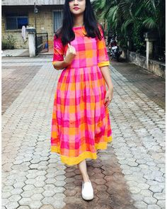The pink and yellow checks cotton dress is a pretty dress perfect for the coming summer season! the dress is made in pure cotton fabric and is adorned with black buttons at the back. The product has pocket on one side. Casual Frocks, Casual Dress Outfits, Casual Summer Dresses, Trendy Dresses, Nice Dresses, Dress Summer, Casual Wear, Summer Outfits, Frock Fashion