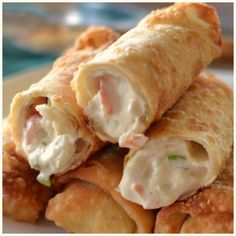 Crab Rangoon Egg Rolls - stuffed with crab, cream cheese, green onions and the perfect blend of spices mimicking the classic crab rangoons