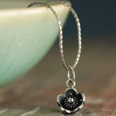 Patinated sterling silver flower and silver chain, how sweet :)
