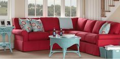 In love with the red couch, and the aqua accents (but not wicker). Maine Cottage® | where color lives