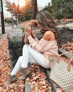 off shoulder sweater, white pants, booties, louis vuitton handbag