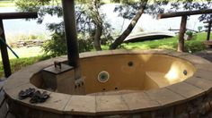 An outdoor jacuzzi we were booked to resurface.  This is the before pic.  Don't replace.  Resurface.