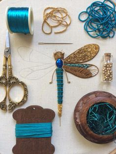 Bedford, England-based embroidery artist Humayrah Bint Altaf (previously) continues to construct ornate insects using shimmering threads and metallic beads. Her dragonflies, bees, beetles, and …humayrah_bint_altaf - Persnickety (adj. Embroidery Designs, Hand Embroidery Stitches, Embroidery Techniques, Ribbon Embroidery, Beaded Embroidery, Cross Stitch Embroidery, Simple Embroidery, Embroidery Fashion, Bullion Embroidery