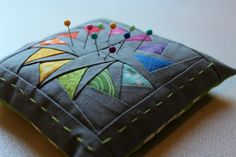 A Quilter's Table - Circle of Geese pincushion; block pattern by Piece by Number, printed at 33%