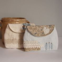 Pouches blue and antique linen by Roxy Creations, via Flickr