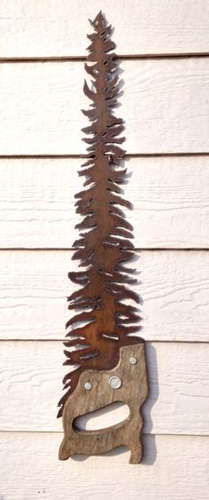 Plasma cut hand saw tree. First attempt at this design.  Made by Roshi