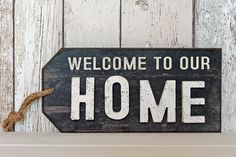 Shabby distressed style home tag. Black wooden sign hung on twine.