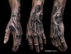 Biomechanisch Hand Tattoo von Spider Monkey Tattoos