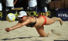 Female Athletes: 21 Photos That Will Make You Appreciate The Power Of A Woman's Body April Ross dives for a ball during the AVP Hermosa Beach Open at the Hermosa Beach Pier on July 17, 2010 in Hermosa Beach, California. #supporteverymove