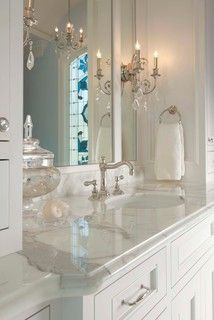 polished nickel fixtures on marble with crystal sconces, timeless glamour