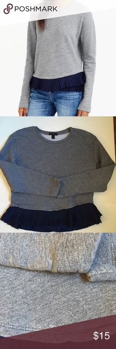J Crew ruffle trim sweatshirt small defect J crew ruffle trim sweatshirt small overall great condition except there is a small hole by the hem detailed in photograph. J. Crew Tops Tees - Long Sleeve
