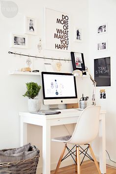 white & clean desk area. love the frames and shelf