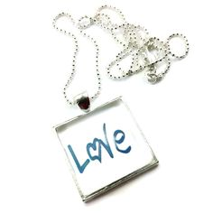 An awesome inspirational penant galss dome necklace with the word 'Love', which is just what most of us need to be reminded of. Love oursleves and each other.