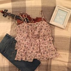 Forever 21 Floral Ruffle Shirt This floral shirt is so cheerful and great for spring or summer time. Goes great with jeans or cute shorts, and definitely gives a pop of style to any outfit! Forever 21 Tops
