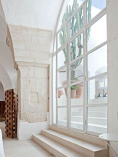 An abandoned Puglia oil mill in the Italian countryside is transformed by PalombaSerafini to become perfectly geared towards rustic modern living.