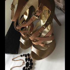 "HPMichael Kors stiletto sandals  OBO Olive and brown leather. Tiered leather straps unite with a sensible stiletto heel on stunning sandals. They standout style is the perfect base for any outfit! From jeans to dress ! 4"" worn twice ! Michael Kors Shoes Sandals"