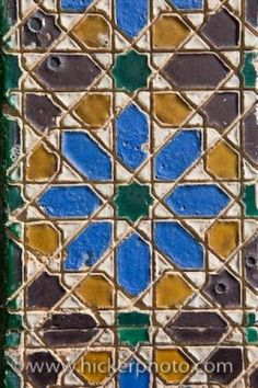 A ceramic tile mosaic is a unique design that decorates the entranceway to a building in the Santa Cruz District in the City of Sevilla in Andalusia, Spain. Spanish Tile, Andalusia, Mosaic Tiles, Building Design, Group, Pictures, Home Decor, Santa Cruz, Mosaic Pieces