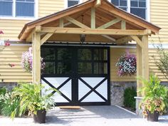 Love the porch idea to stop rain from blowing into the barn