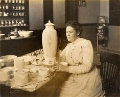 Adelaide Alsop Robineau at work. (1865-1929). A 20th c. Studio Art Movement pioneer, she helped some potters make the transition from factory throwers towards establishing their own studios. She was also one of the first women to boldly pursue learning to throw on the potter's wheel.