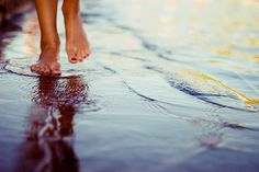 feeling the warm waves and the wet sand underneath my toes
