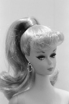 My first Barbie..1959...If I only had her & the outfits now...what a treasure I would have!!