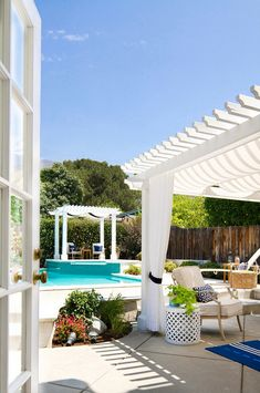 Backyard. French Doors lead to a casually elegant backyard patio inspired by the East Coast. A relaxed Hamptons style deck lends to family BBQs and relaxing in the afternoons. Turquoise accents and a range of blue fabrics pop against white and cream backgrounds. #backyard Talianko Design Group, LLC