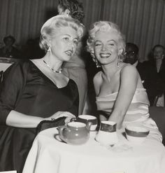 Marilyn with Sheila Graham at Walter Winchell's birthday party at Ciro's, 13 May 1953.