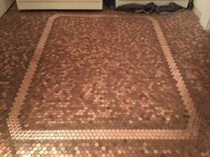 The finished product! Stunning!  Gluing pennies to the floor.  Time consuming but awesome when finished.