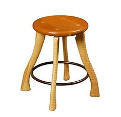 """18"""" Ax Handle Stool. The Ax Handle Stool is known as the origin of the Bradford Woodworking family of furniture. The legs are solid ash turned on a century old ax handle lathe. This creates a rippled texture. The solid cherry seat is contoured so that everybody will find comfortable. There is a solid steel ring that serves as a footrest."""
