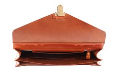 Vegetable tanned leather briefcase with steel reinforced flap to secure shape. Subtle yet unique design with a spacious interior to store your everyday items.