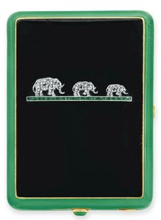AN ART DECO DIAMOND AND ENAMEL VANITY CASE, BY VAN CLEEF & ARPELS. Of rectangular outline, the black and green enamel vanity case, set with rose-cut diamond elephants on a calibré-cut emerald bar, the cabochon pushpiece opening to reveal a fitted mirror, a concealed compartment and a lipstick case, mounted in 18k gold, circa 1925, with French assay marks. Signed Van Cleef & Arpels, Paris, numbered. #VanCleef #Arpels #ArtDeco #vanity