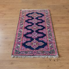 kismet rug in navy and pinks perfect for the hallway
