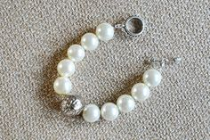 The Habersham    Handmade bracelet made with glass pearls. Toggle closure. Makes the perfect statement piece for every outfit from classy to