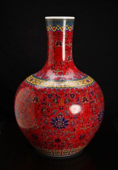 """Chinese Porcelain Vase. Printed vase in red ground with symbols, flowers, scrolling designs, bats and stiff petals. Six character mark to underside. 20.5"""" H x 13"""" W."""