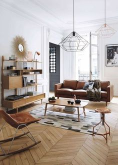 Minimal wire lighting, leather furniture, white walls