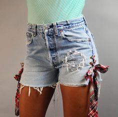 UPCYCLED Denim SHORTS / Side Lace Up Levi cutoff Blue Jean shorts / destroyed frayed & custom patched denim cutoffs Size 30 Waist. $64.00, via Etsy.