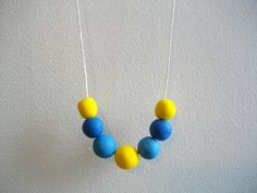 Blue and yellow polymer clay necklace with round beads. $22,00, via Etsy.
