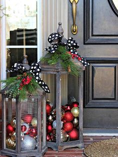 Glitzy red, gold, and silver ornaments spruce up two large lanterns, an easy and inexpensive way to add flair to a front porch. Top the lanterns with greenery and polka-dot bows for added holiday spirit. /