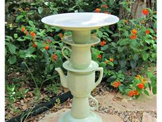 DIY Teacup Birdbath... could be something different