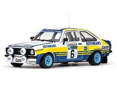 This Ford Escort MkII (Ari Vatanen - RAC Rally Diecast Model Car is Blue and Yellow and features working steering, suspension, wheels and also opening bonnet with engine, boot, doors. It is made by Sun Star and is scale (approx. Miniature Cars, Ford Escort, Diecast Model Cars, Rally Car, Scale Models, Race Cars, Yellow, Blue, Engine