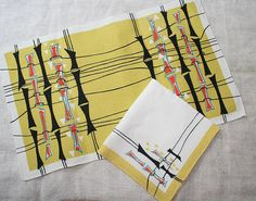 1950s table linen napkin & placemat set - stylised bamboo in black, orange, teal on yellow/white on Etsy, $38.00