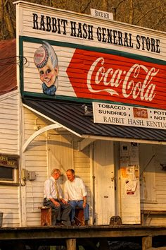 Country gentlemen enjoying casual conversation on porch of Rabbit Hash General Store, KY