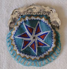 Seven pointed star, typical for our region Zeeland - The Netherlands .Silver frame antique beads. New knitted by Tineke Nieuwenhuijse