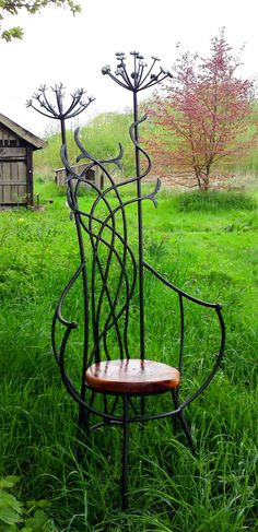 'Oberon's Chair' (2010) by English artist blacksmith & sculptor David Freedman Sculpture. Galvanized wrought iron & burr oak. via the artist's site