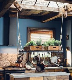 I Love About My Kitchen pot rack on a pulley system! LOOK at the cool skylight.makes sense to put herbs on the shelfpot rack on a pulley system! LOOK at the cool skylight.makes sense to put herbs on the shelf