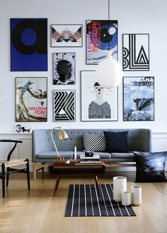 art wall and gray couch.