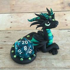 Aqua dice dragon by Dragonsandbeasties Polymer Clay Dragon, Polymer Clay Animals, Polymer Clay Crafts, Tiny Dragon, Dragon Art, Diy Air Dry Clay, Biscuit, Clay Art Projects, Cute Dragons