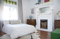 White fireplace with exposed firewood