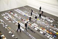 idea is give people place cards to form a key message before they enter the gs/showcase or smth. can be team bonding also. OR place cards already on the floor just flip them over to see what the final image/message is Exhibition Display, Exhibition Space, Museum Exhibition, Exposition Interactive, Exposition Photo, Museum Displays, Photography Exhibition, Guerilla Marketing, Book And Magazine